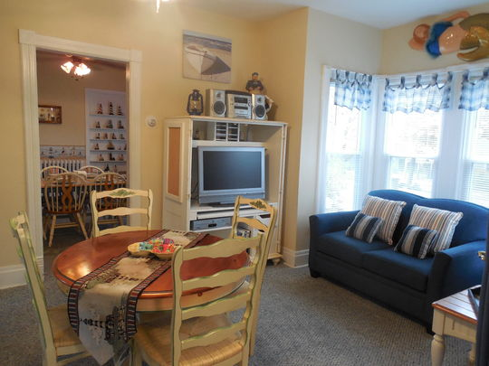 Loveseat, Dining Table With 4 Chairs, Television, VCR, DVD Player, Cable,  Stereo With CD Player. Located Adjacent The Dining Room.